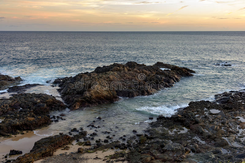 Al, Saints Bay. Sunset on the Bay of All Saints side of the Barra Lighthouse in Salvador royalty free stock photo