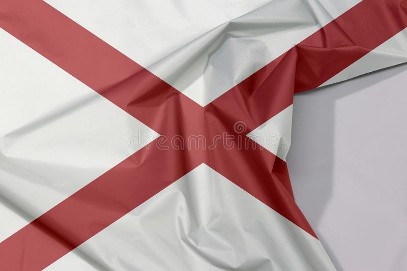 Alabama fabric flag crepe and crease with white space, The states of America. stock photos