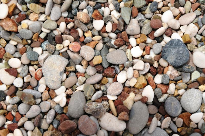 Alacati surf center, Turkeys most beautiful holiday attractions. Accumulated delectable sea stones on the beach stock image