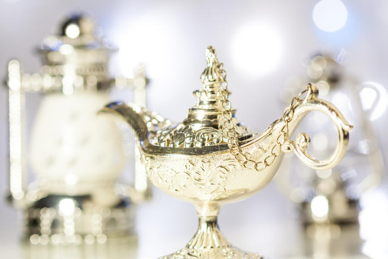 Aladdin's magic lamp. With out of focus light as background royalty free stock images