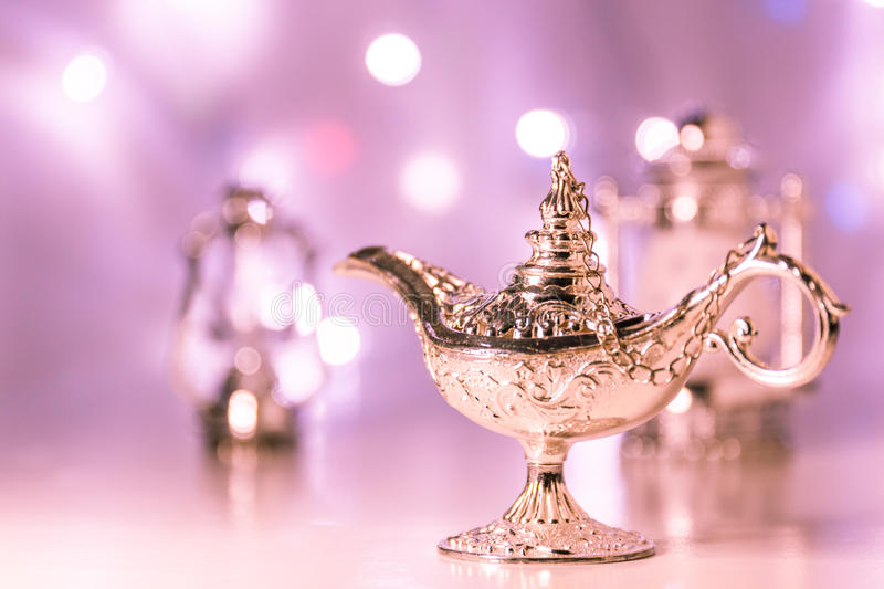 Aladdin's magic lamp. With out of focus light as background stock photos