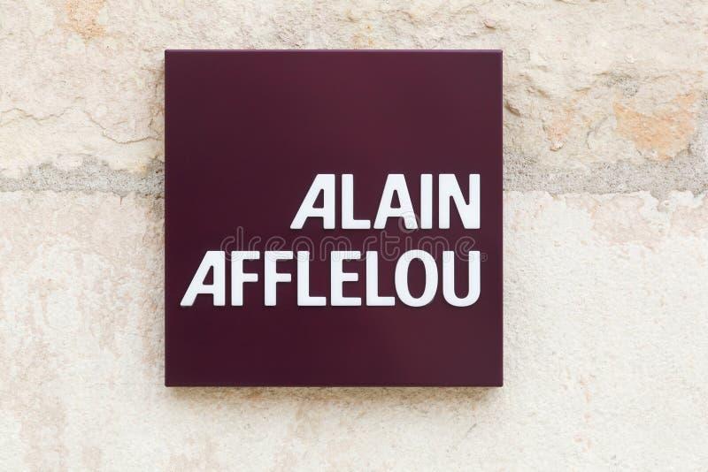 Alain Afflelou Logo an der Wand lizenzfreies stockbild
