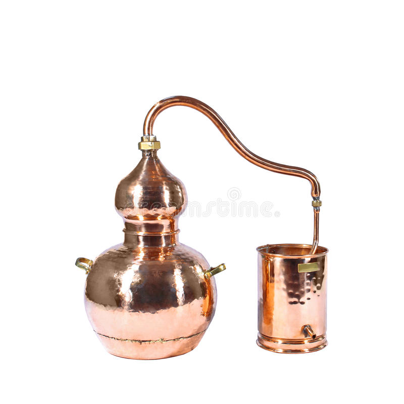 Alambic. An alembic from Arabic الإنبيق al-anbīḳ; from Greek ἄμβιξ ambix, meaning `cup, beaker` is an royalty free stock photo