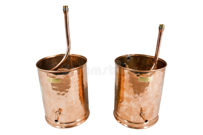 Alambic. An alembic from Arabic الإنبيق al-anbīḳ; from Greek ἄμβιξ ambix, meaning `cup, beaker` is an royalty free stock photos