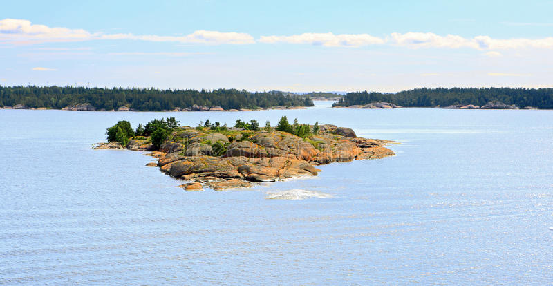 Aland Islands archipelago, view from cruise ship. Tiny rocky island in Aland Islands archipelago in summer royalty free stock image