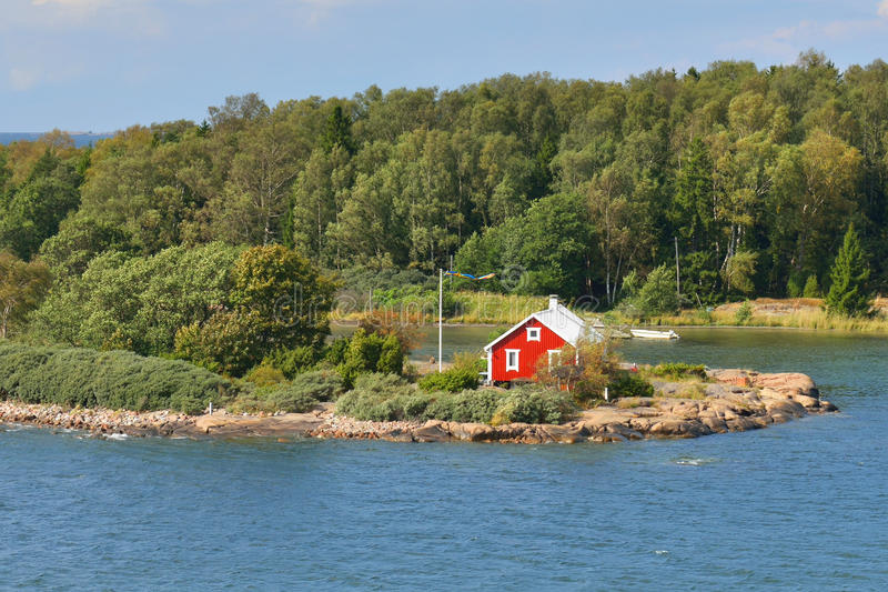 Aland Islands, Finland. Life on small island. Red house on rocky shore of Baltic Sea. Aland Islands, Finland royalty free stock photography