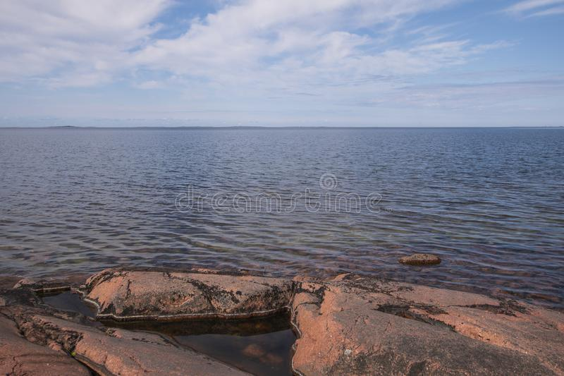 Aland Islands, Finland  - View of the embankment. Coast of the Baltic Sea. Aland Islands, Finland  - View of the embankment with  on the Aland Islands. Coast of royalty free stock photography
