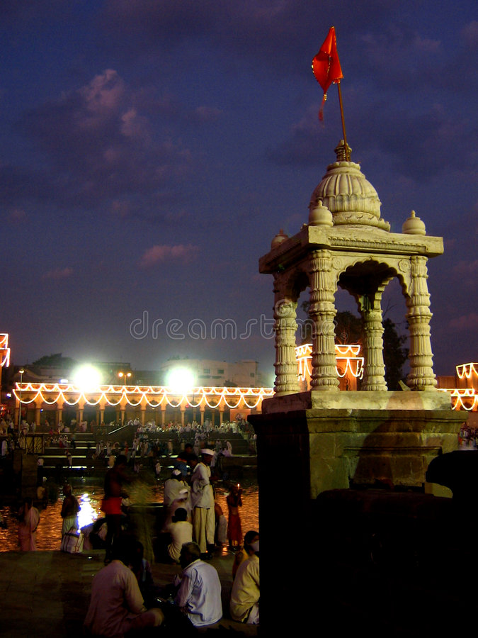 Alandi Temple. A small temple stands amongst the many others surrounding the main temple in Alandi.Pilgrims gather in thousands at the pilgrimmage of Alandi near royalty free stock image