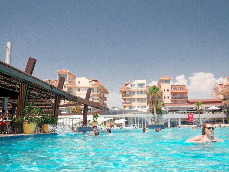 Alaniya 2015 pool. beach umbrellas and waterslides at the pool1 stock photography