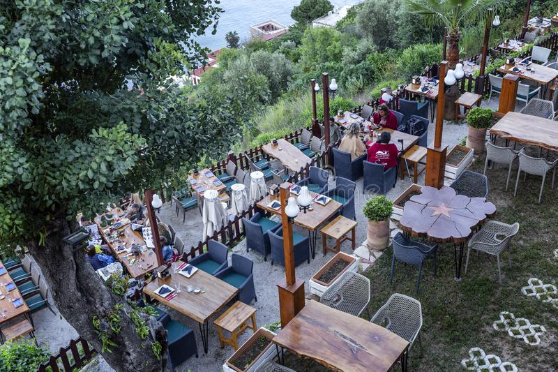 Alanya, Turkey, 05/08/2019: Beautiful top view of a coastal cafe in the resort. Horizontal stock images