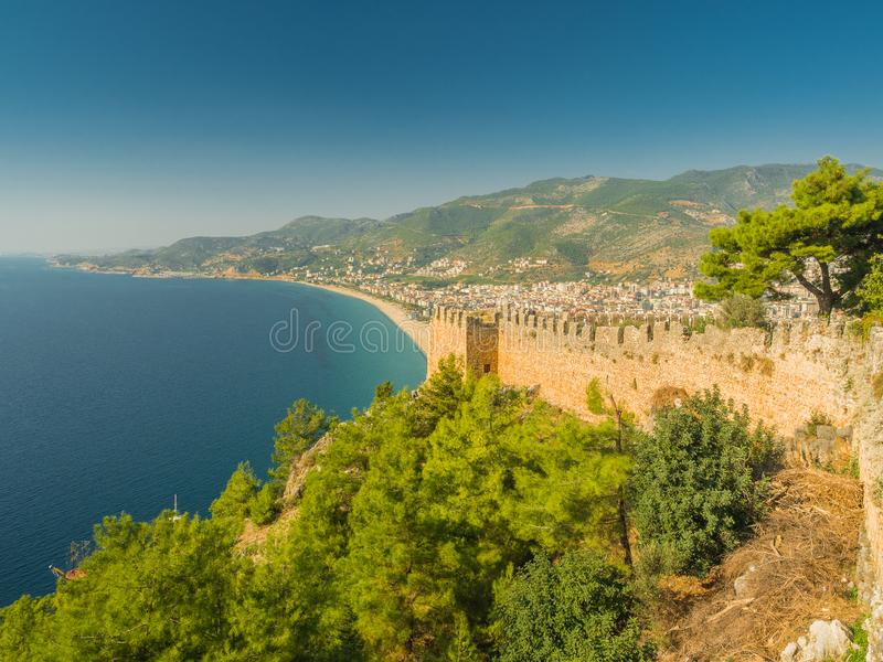 Alanya, Turkey. Beautiful view from the fortress Alanya Castle of the Mediterranean Sea and Cleopatra beach at sunset. Vacation royalty free stock photo