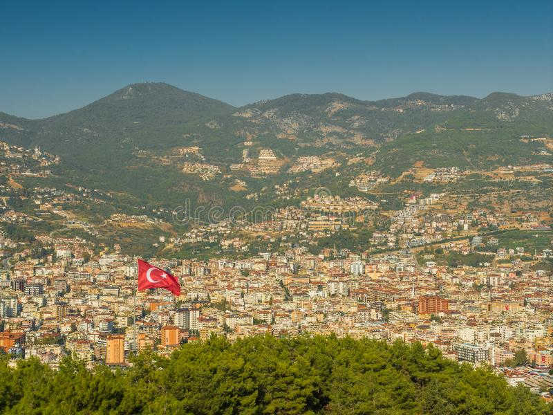 Alanya, Turkey. Beautiful view from the fortress Alanya Castle of the turkish flag on the background of the city of Alanya. stock images