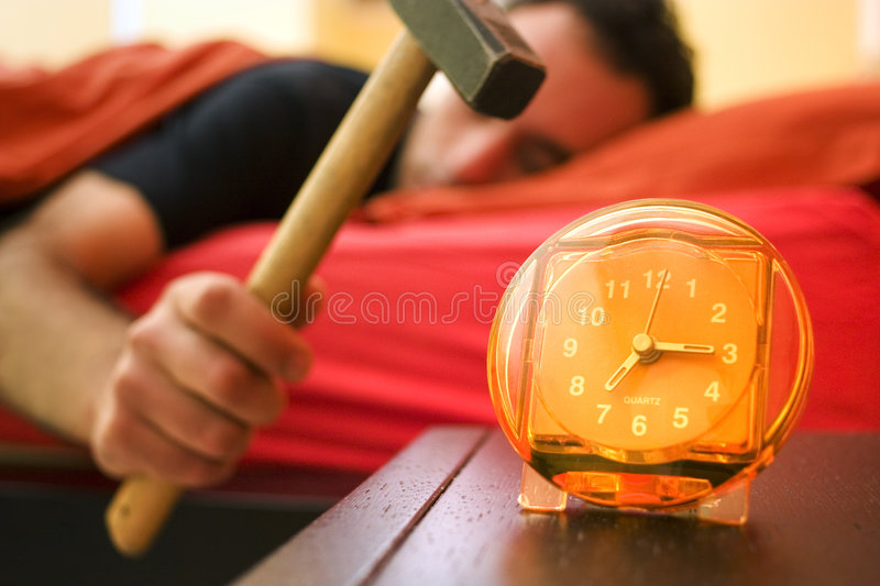 Alarm clock 01. The guy doesnt want to get up stock images