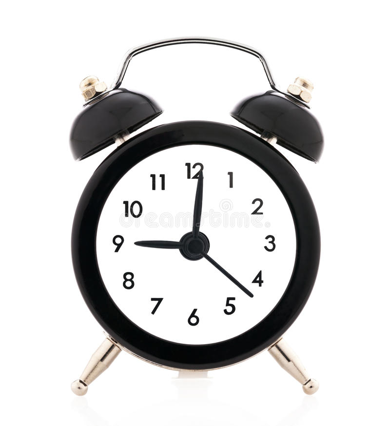 Alarm clock. Twin bell alarm clock on white background stock photo
