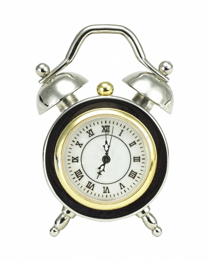 Alarm clock. Old-fashioned alarm clock set for seven o'clock in the morning to start a new day royalty free stock photography