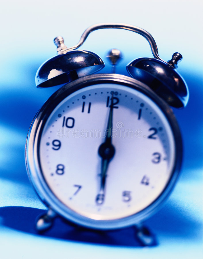 Alarm Clock. In blue tones, film grain visible royalty free stock photo