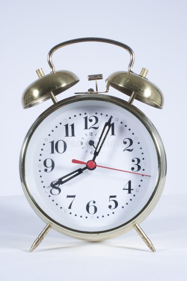 Alarm Clock. A windup alarm clock on white background