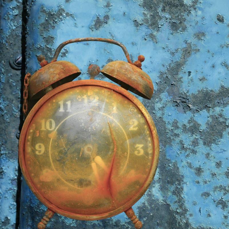 Alarm clock against blue. royalty free stock photo