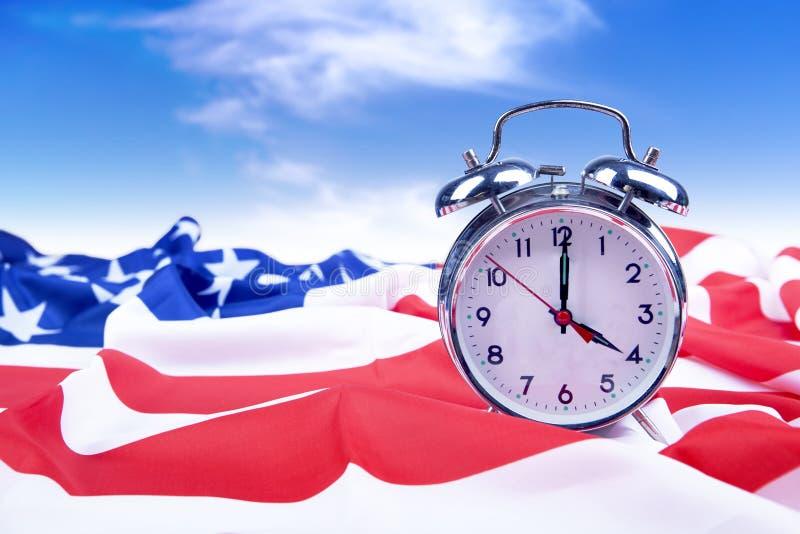 Alarm clock with American flag stock photos