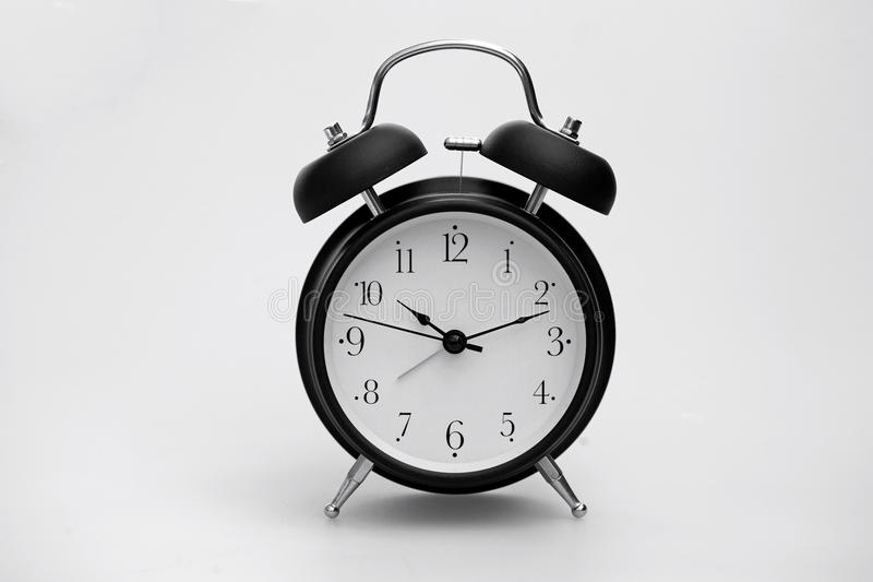 Alarm Clock. Black Alarm Clock Isolated on White Background stock photos