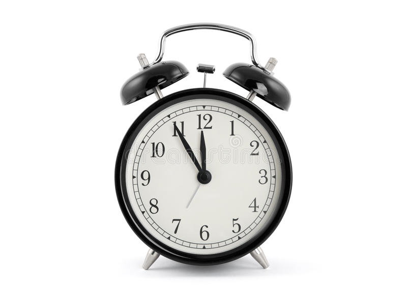 Alarm clock. Black old style alarm clock with clipping path royalty free stock photo
