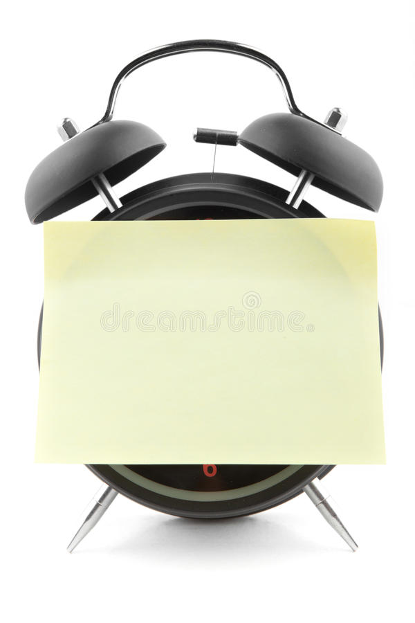 Alarm Clock With A Blank Note Pad Royalty Free Stock Photography