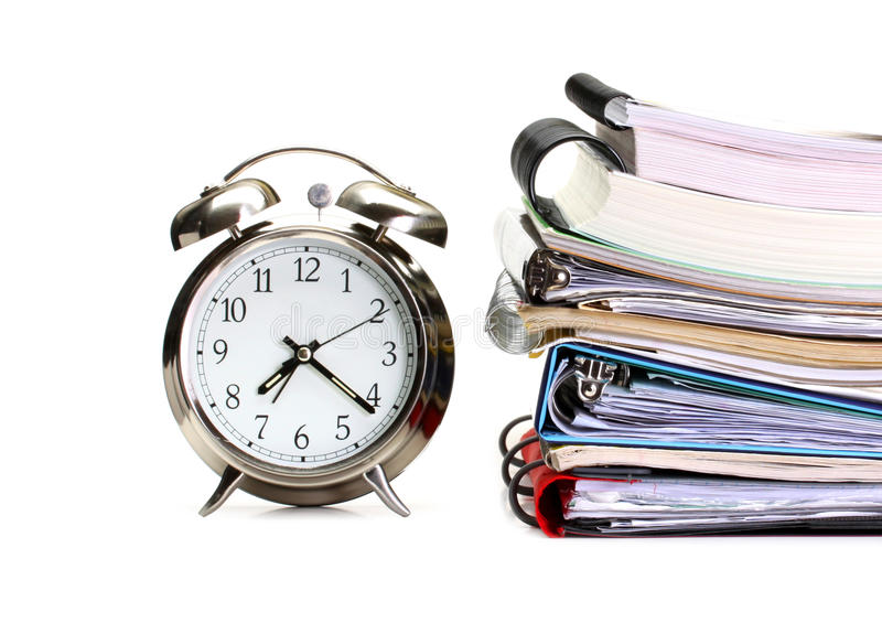 Alarm clock, books, copy books and folders royalty free stock images