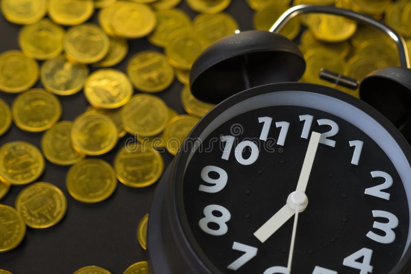 Alarm clock and coins stacks on working table, time for savings money concept, banking and business concept stock images
