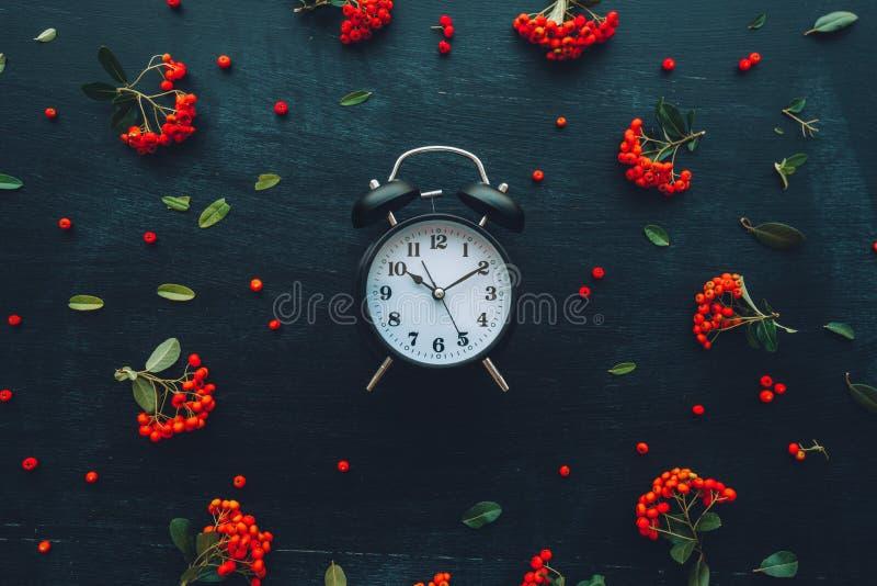 Alarm clock on dark background, flat lay stock photo