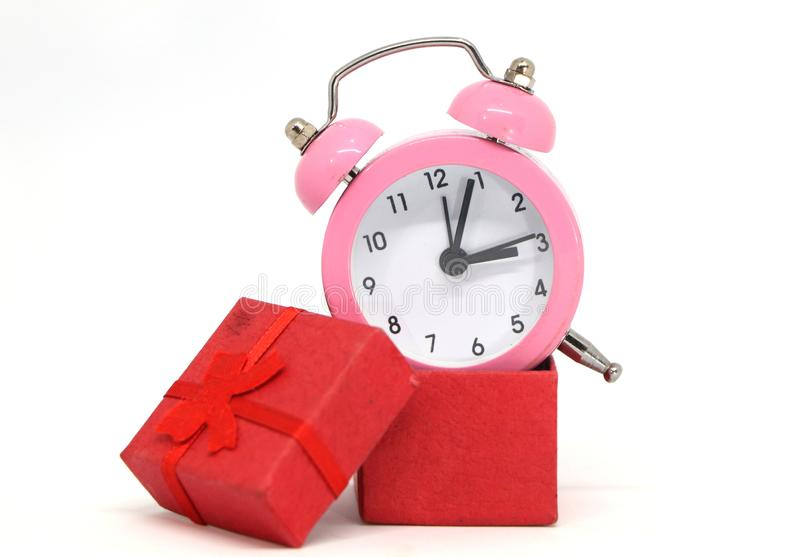 Alarm clock in a gift box. stock image