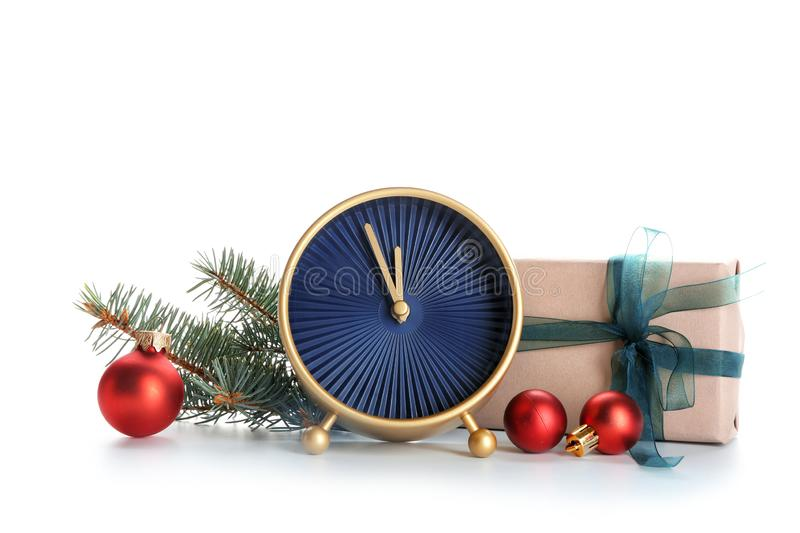Alarm clock with gift and decorations on white background. Christmas countdown stock image