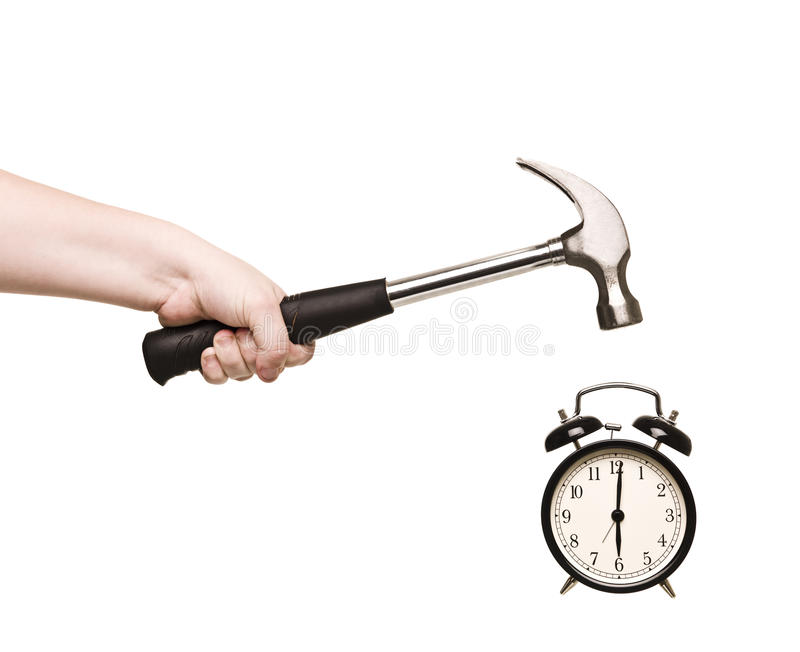 Alarm Clock and hammer in hand. Isolated on white background stock photography
