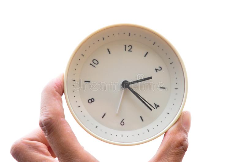 The alarm clock. Of Hand holding stock photography