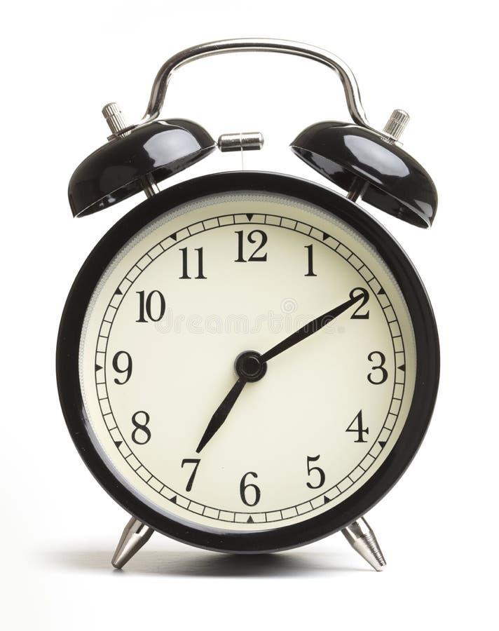 Alarm clock isolated on white background. Black alarm clock isolated on white background stock photography