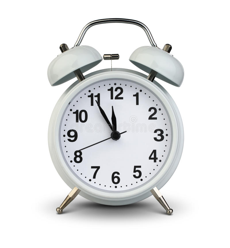 Alarm clock isolated on white, clipping path. Five minutes to twelve stock image