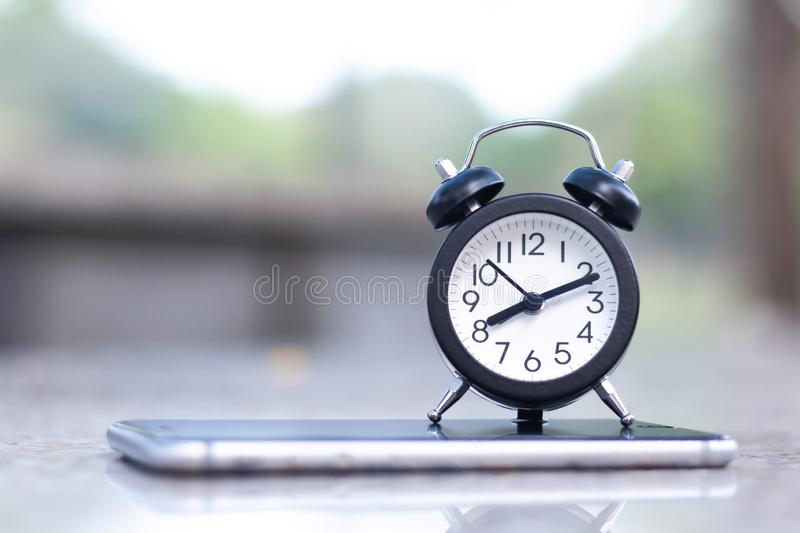 Alarm clock on mobile smart phone with copy space stock images