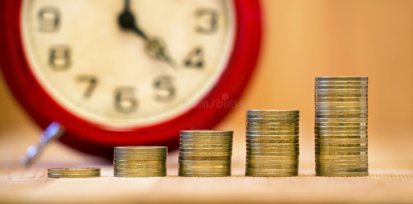 Alarm clock and money coins royalty free stock photography