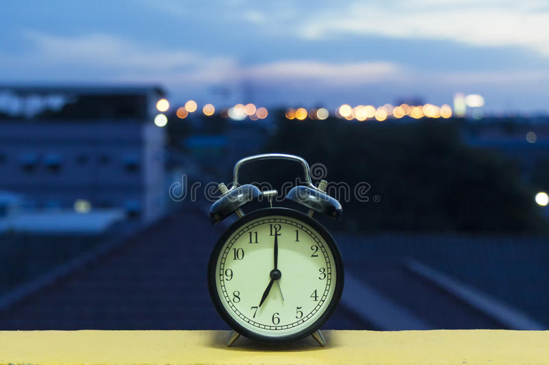 The Alarm clock. In the Morning of city stock image
