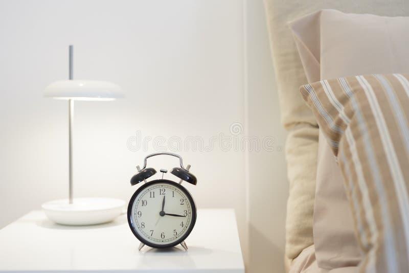 Alarm clock. On the nightstad stock photo