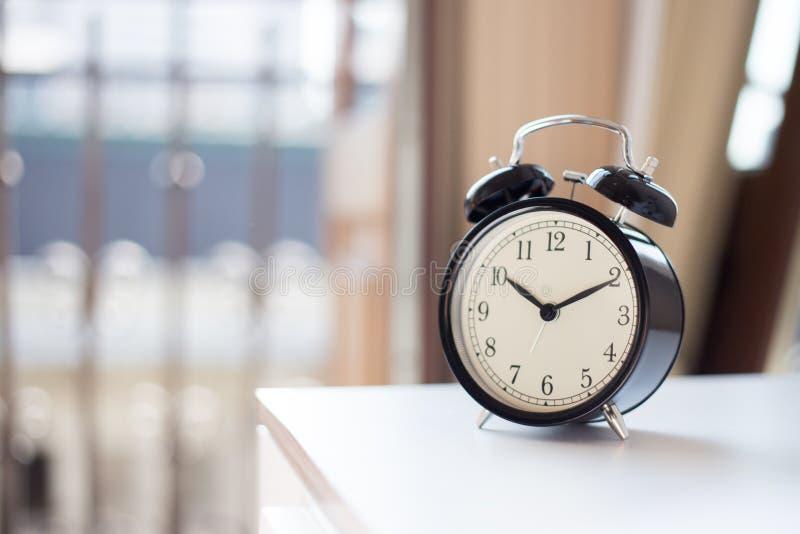 Alarm clock. On the nightstad royalty free stock image