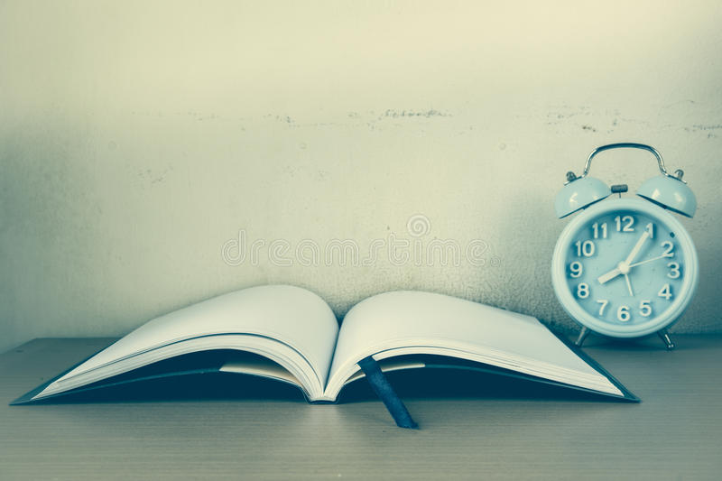 Alarm clock and notebook, diary for memo story. On table royalty free stock photos