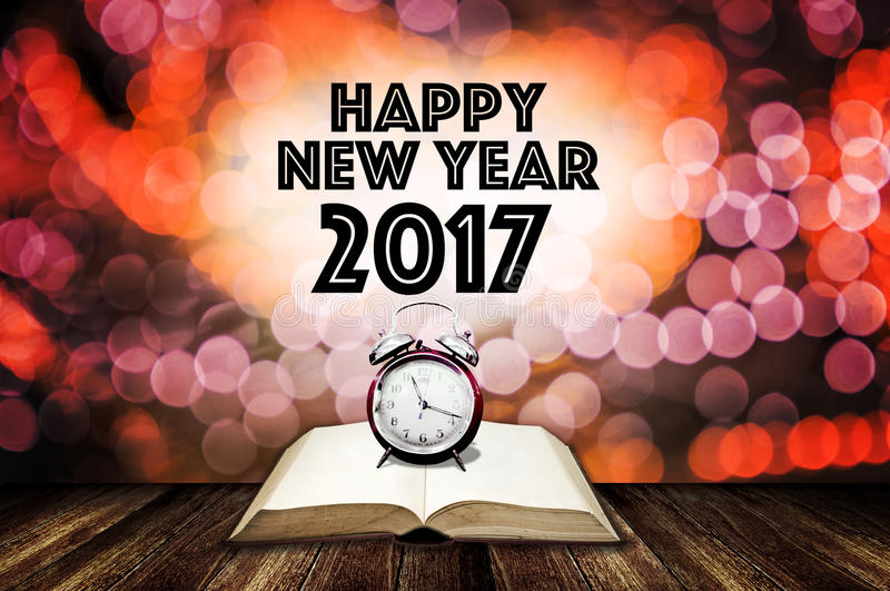 Alarm clock on open book with happy new year word stock image download alarm clock on open book with happy new year word stock image image of m4hsunfo Image collections