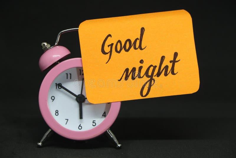 Alarm clock good night note. royalty free stock photography