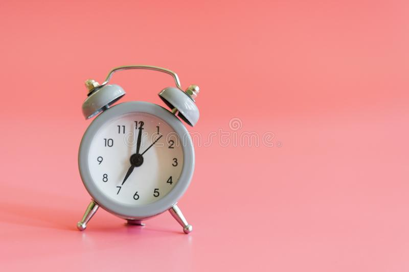 Alarm clock on pink background. Vintage style alarm clock with copy space for text. Alarm clock on pink background. Vintage style alarm clock with copy space royalty free stock images