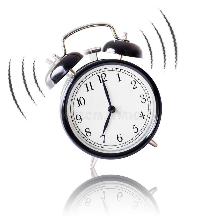 Alarm clock ringing on white background stock image