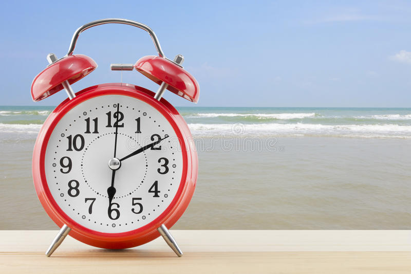 Download Alarm Clock With Sea And Beach Background Stock Image - Image of beautiful, resort: 83708443