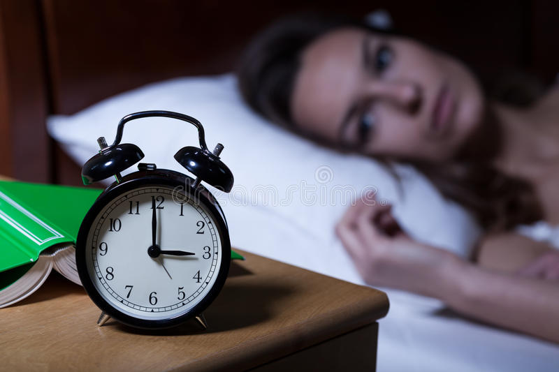 Alarm clock showing 3 a.m. stock image