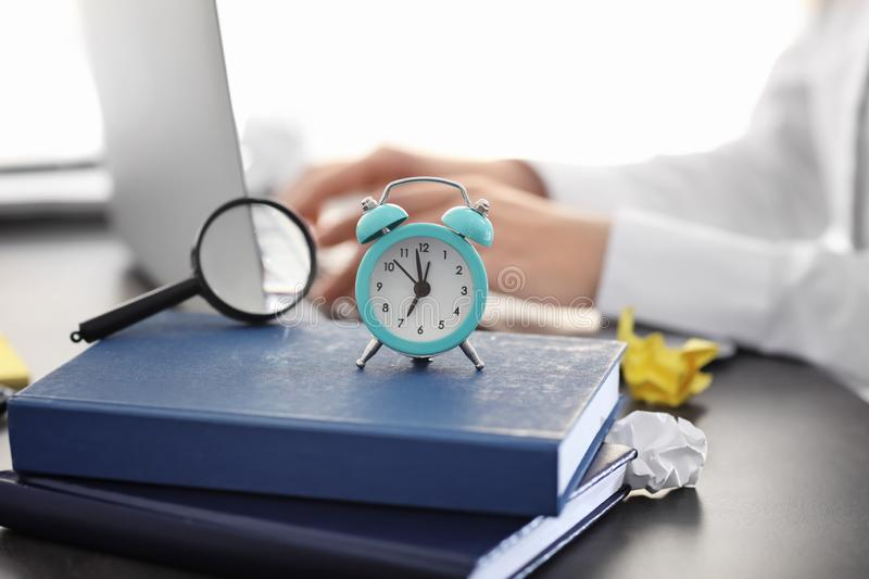 Alarm clock on stack of books stock photos