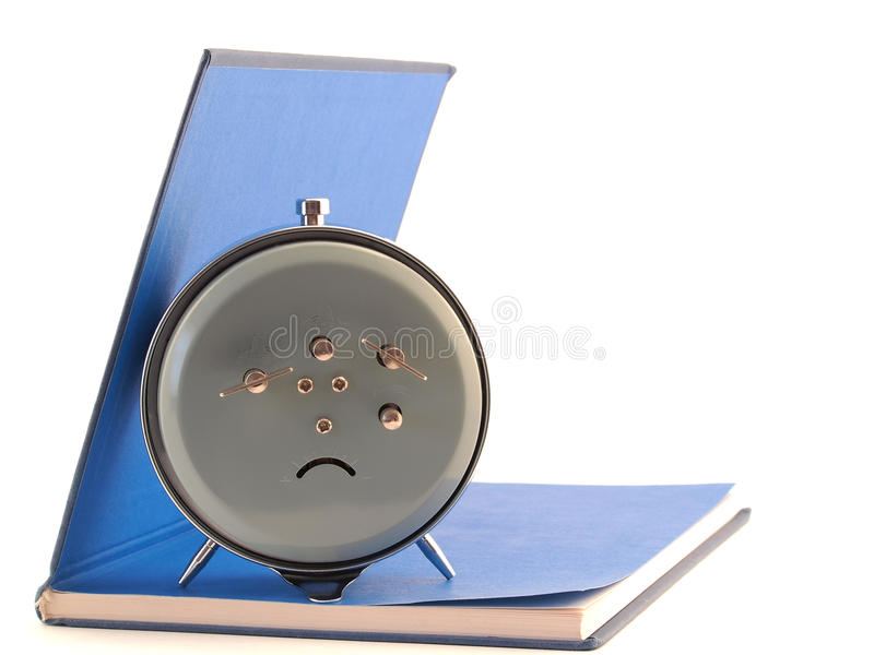 Download The Alarm Clock Standing On The Open Book Stock Image - Image: 31357923
