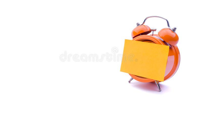 Alarm clock with sticky note on white background. royalty free stock photos